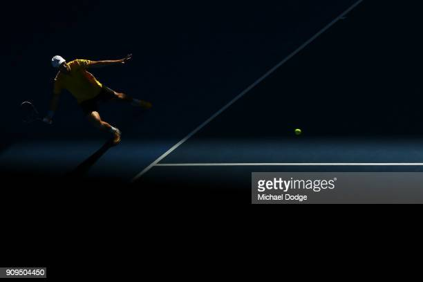 Dominic Inglot of Great Britain returns serve in his men's doubles quarterfinal match with Marcus Daniell of New Zealand against Oliver Marach of...