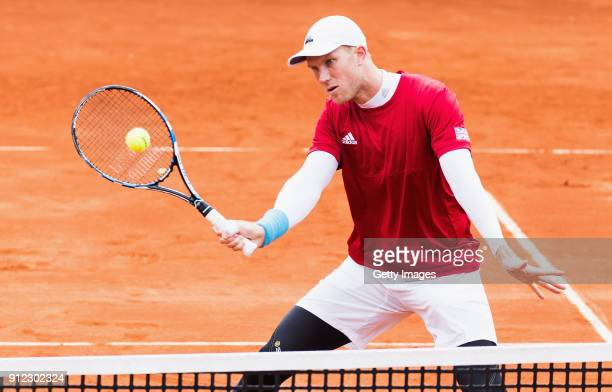 Dominic Inglot of Great Britain volleys during practice ahead of the Davis Cup by BNP Paribas World Group First Round match between Spain and Great...