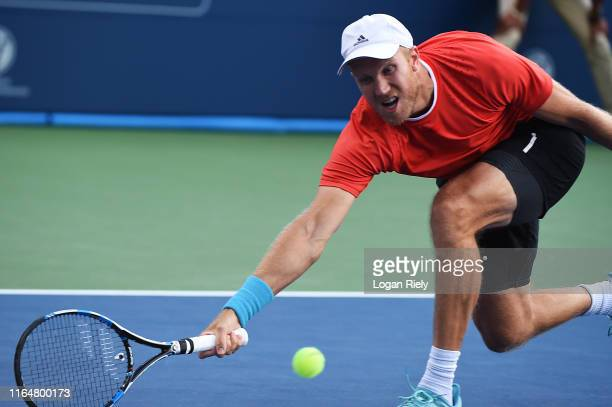 Dominic Inglot of United Kingdom returns a forehand to Bob Bryan and Mike Bryan during the BB&T Atlanta Open at Atlantic Station on July 28, 2019 in...