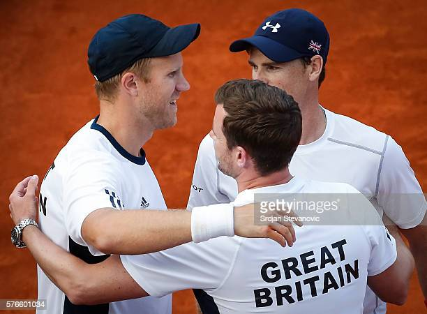 Dominic Inglot team captain Leon Smith and Jamie Murray of Great Britain celebrate victory against Nenad Zimonjic and Filip Krajinovic after day two...