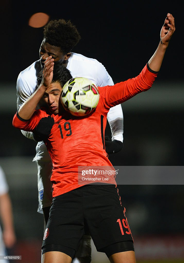 Dominic Iorfa of England rises above Guillermo Martinez Ayala of Mexico during the U20 International Friendly match between England and Mexico at The Hive on March 25, 2015 in Barnet, England.