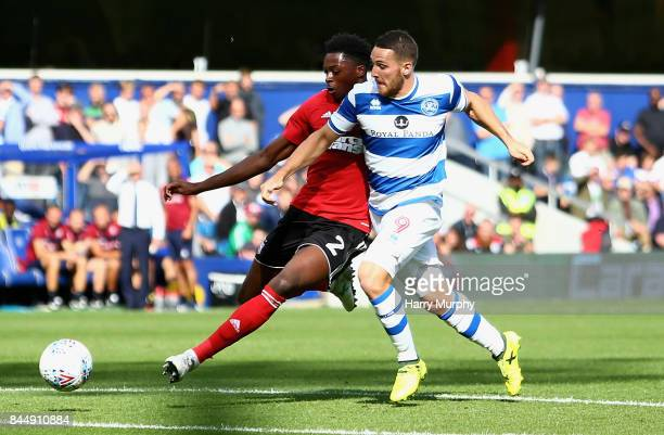 Dominic Iorfa of Ipwich Town and Conor Washington of Queens Park Rangers battle for possession during the Sky Bet Championship match between Queens...