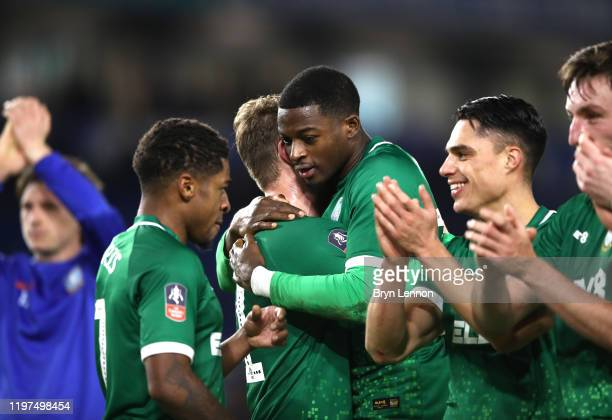 Dominic Iorfa of Sheffield Wednesday celebrates with teammate Sam Winnall after their team's victory in the FA Cup Third Round match between Brighton...