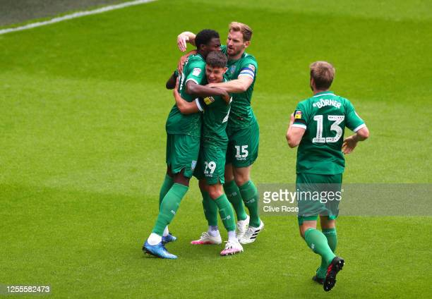 Dominic Iorfa of Sheffield Wednesday celebrates with teammates after scoring his team's first goal during the Sky Bet Championship match between...