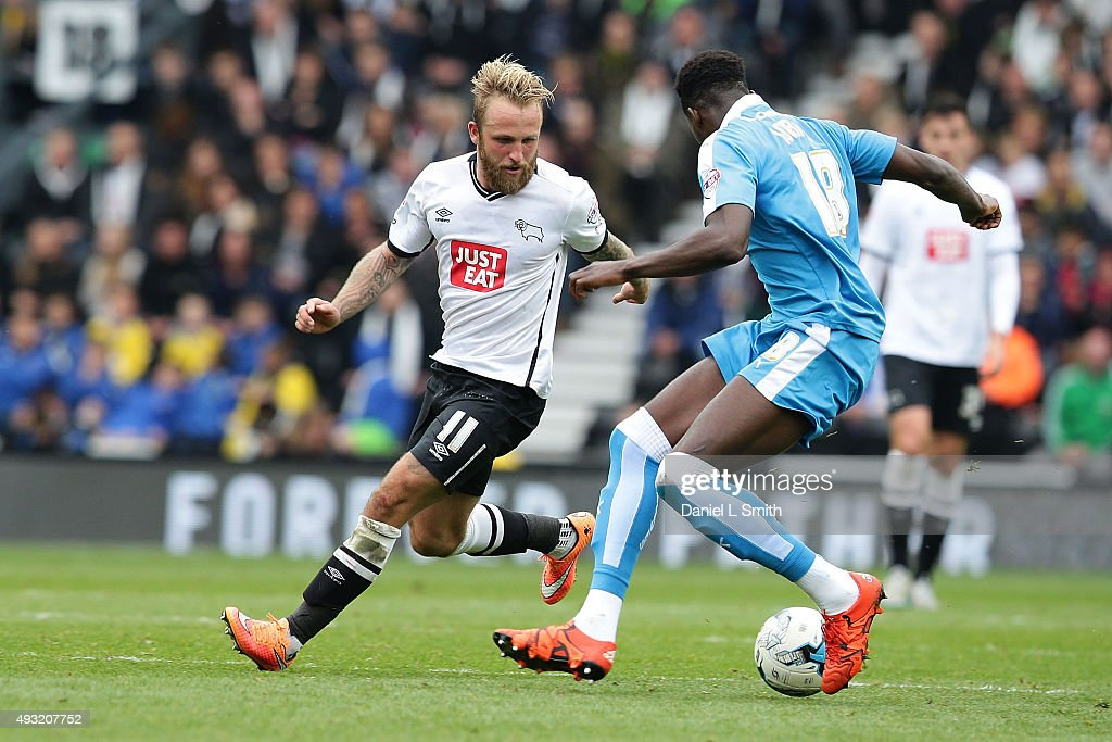 Dominic Iorfa of Wolverhampton Wanderers FC wins possession after a successful tackle of Johnny Russell of Derby County FC during the Sky Bet Championship match between Derby County and Wolverhampton Wanderers at Pride Park Stadium on October 18, 2015 in Derby, England.