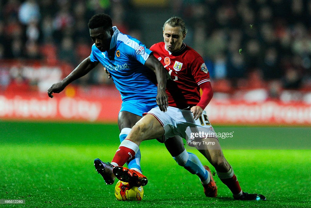 Dominic Iorfa of Wolverhampton Wanderers is tackled by Luke Freeman of Bristol City during the Sky Bet Championship match between Bristol City and Wolverhampton Wanderers at Ashton Gate on November 3, 2015 in Bristol, England.