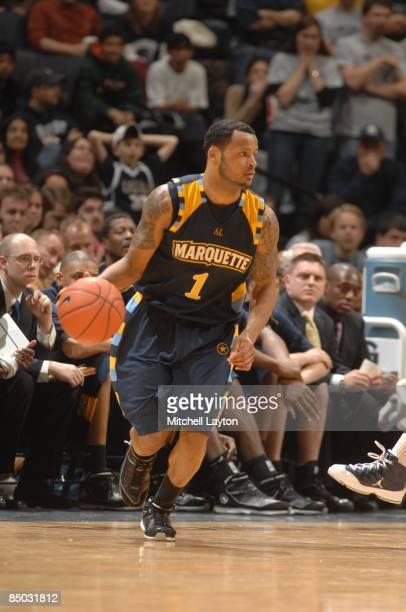 Dominic James of the Marquette Golden Eagles dribbles the ball during a college basketball game against the Georgetown Hoyas on February 21 2009 at...