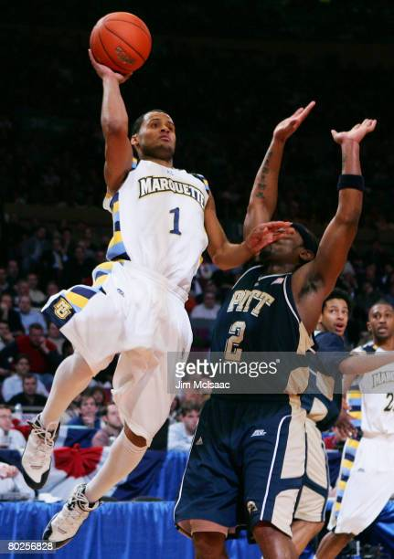 Dominic James of the Marquette Golden Eagles goes to the hoop against Levance Fields of the Piittsburgh Panthers during day three of the 2008 Big...