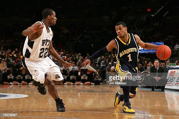 Dominic James of the Marquette Golden Eagles handles the ball against Antonio Graves of the Pittsburgh Panthers during the quarterfinals of the Big...