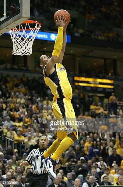 Dominic James of the Marquette Golden Eagles lays in a reverse dunk against the Louisville Cardinals on February 17 2007 at the Bradley Center in...