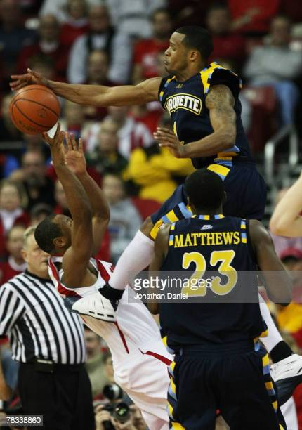 Dominic James of the Marquette Golden Eagles leaps to block a shot by Trevon Hughes of the Wisconsin Badgers at the Kohl Center December 8 2007 in...