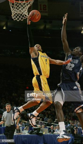 Dominic James of the Marquette Golden Eagles shoots against Jeff Green of the Georgetown Hoyas during the quarterfinals of the Big East Men's...