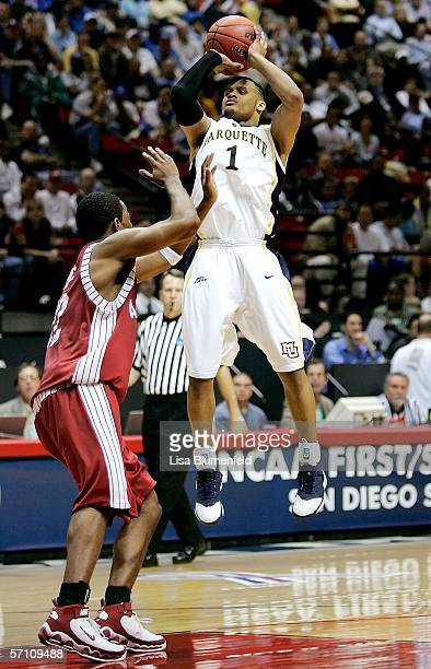 Dominic James of the Marquette Golden Eagles shoots the ball against Ronald Steele of the Alabama Crimson Tide during the first round of the NCAA...