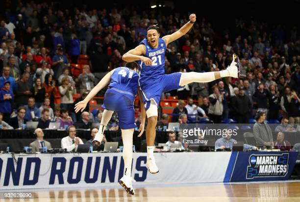 Dominic Johnson of the Buffalo Bulls celebrates with Brock Bertram in the second half against the Arizona Wildcats during the first round of the 2018...