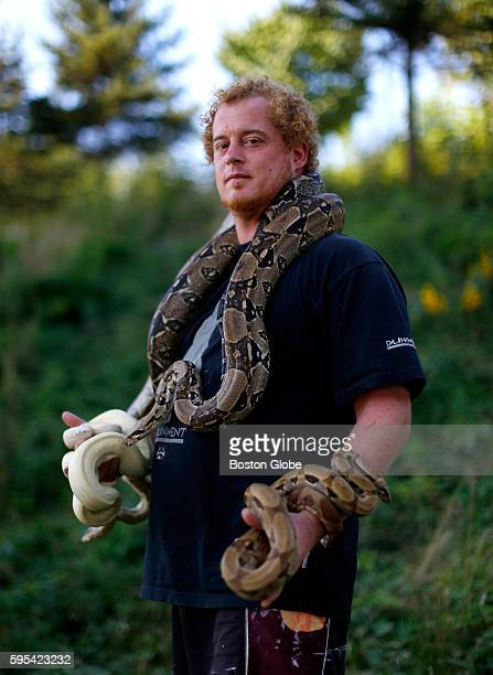 Dominic Kane posed for a portrait with some of the snakes that he and his brother Nick Warchol keep and breed in Portland Maine Aug 24 2016 Kane and...