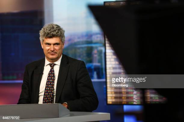 Dominic Konstam managing director of Deutsche Bank Securities Inc listens during a Bloomberg Television interview in New York US on Tuesday Feb 28...