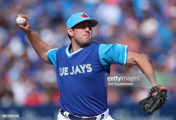 Dominic Leone of the Toronto Blue Jays delivers a pitch in the eighth inning during MLB game action against the Minnesota Twins at Rogers Centre on...