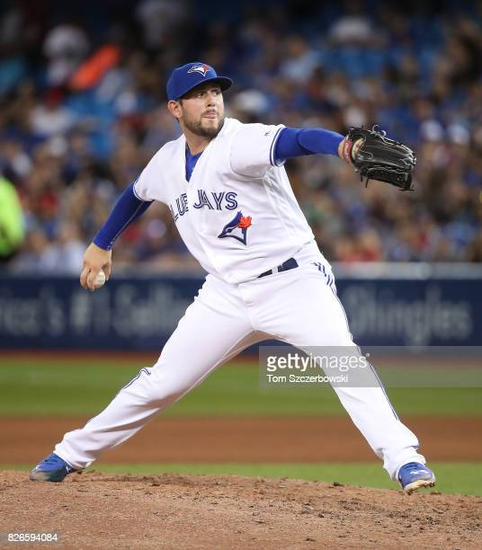 Dominic Leone of the Toronto Blue Jays delivers a pitch in the seventh inning during MLB game action against the Los Angeles Angels of Anaheim at...
