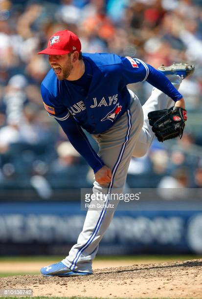 Dominic Leone of the Toronto Blue Jays in action against the New York Yankees during a game at Yankee Stadium on July 4 2017 in the Bronx borough of...