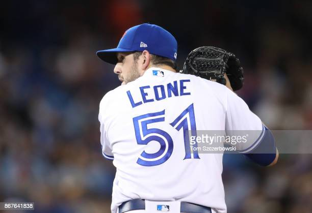 Dominic Leone of the Toronto Blue Jays looks in before delivering a pitch in the seventh inning during MLB game action against the Oakland Athletics...