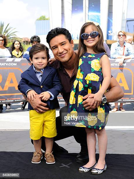 "Dominic Lopez, Mario Lopez and Gia Francesca Lopez pose together at ""Extra"" at Universal Studios Hollywood on June 15, 2016 in Universal City,..."