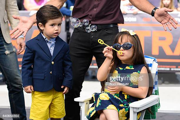 "Dominic Lopez watches Gia Francesca Lopez blow bubbles at ""Extra"" at Universal Studios Hollywood on June 15, 2016 in Universal City, California."