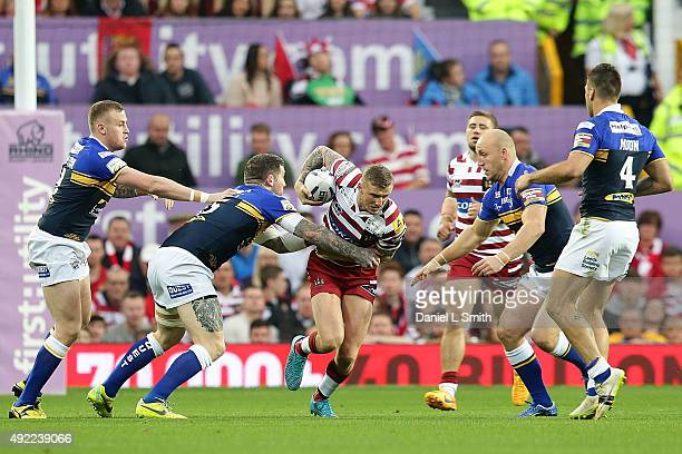 Dominic Manfredi of Wigan Warriors in possession as he attempts to break past Brett Delaney of the Leeds Rhinos during the First Utility Super League...