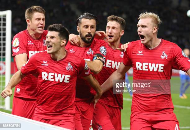 Dominic Maroh of Koeln jubilates with team mates after scoring the second goal during the DFB Cup match between Hertha BSC and 1 FC Koeln at...