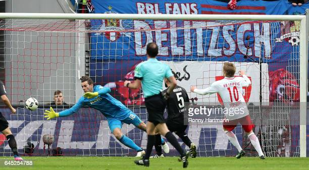 Dominic Maroh of Koeln scores an own goal next to Goalkeeper Thomas Kessler of Koeln during the Bundesliga match between RB Leipzig and 1 FC Koeln at...