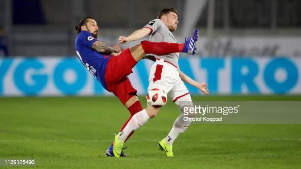 Dominic Maroh of Krefeld challenges Christian Kuehlwetter of Kaiserslautern during the 3 Liga match between KFC Uerdingen 05 and 1 FC Kaiserslautern...