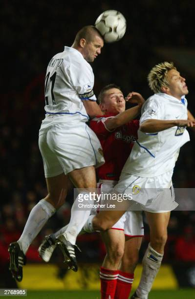 Dominic Matteo and Alan Smith of Leeds United gang up on Matt Holland of Charlton Athletic to clear the ball during the FA Barclaycard Premiership...