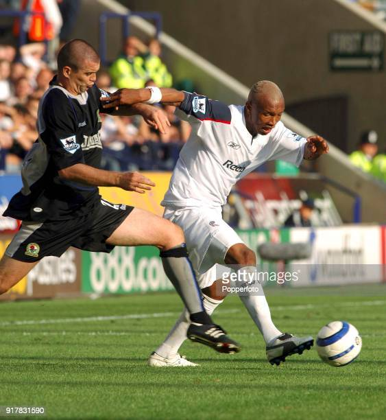 Dominic Matteo of Blackburn Rovers and El Hjadji Diouf of Bolton Wanderers in action during the Barclays Premiership match between Bolton Wanderers...