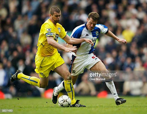 Dominic Matteo of Leeds holds odd Craig Short of Blackburn during the FA Barclaycard Premiership match between Blackburn Rovers and Leeds United at...