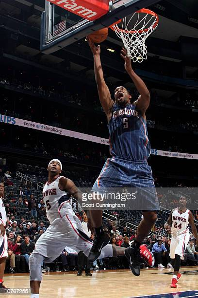 Dominic McGuire of the Charlotte Bobcats shoots against Josh Smith of the Atlanta Hawks during the game on December 17 2010 at Philips Arena in...
