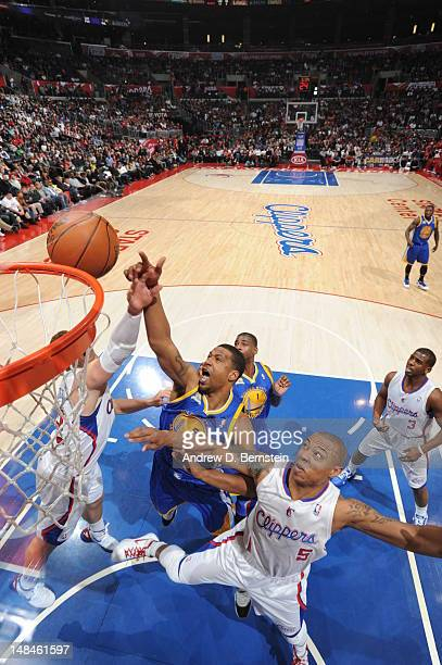 Dominic McGuire of the Golden State Warriors and Caron Butler of the Los Angeles Clippers fight for a rebound during the game at Staples Center on...