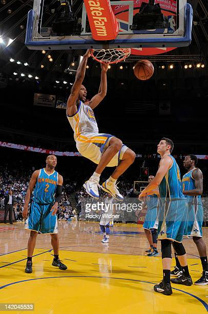 0e5a2f4bf7cb Dominic McGuire of the Golden State Warriors dunks the ball against the New  Orleans Hornets on