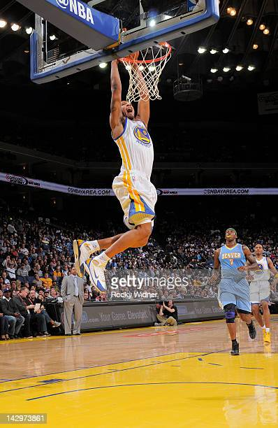 f47af3ea1fcf Dominic McGuire of the Golden State Warriors goes up for the dunk against  the Denver Nuggets