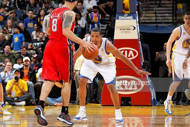 c8ee16976aee Dominic McGuire of the Golden State Warriors playing defense on Deron  Williams of the New Jersey