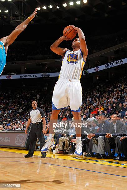 b78ca541d6ec Dominic McGuire of the Golden State Warriors shoots the ball against the  New Orleans Hornets on