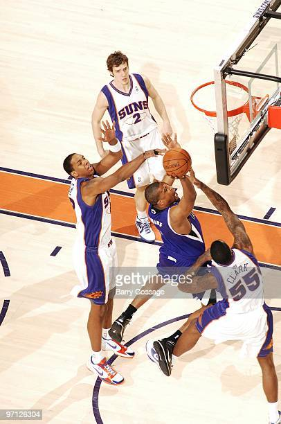 Dominic McGuire of the Sacramento Kings goes up for a layup against Earl Clark and Channing Frye of the Phoenix Suns during the game at US Airways...
