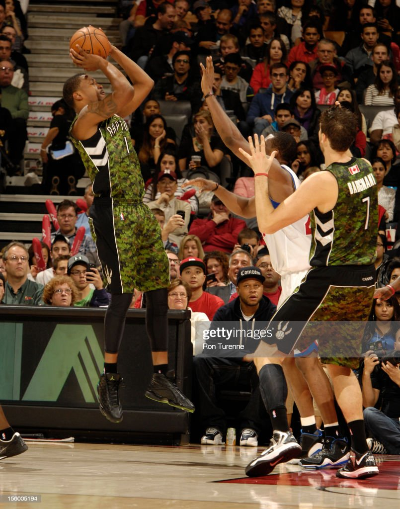 Dominic McGuire #1 of the Toronto Raptors puts up a shot over defenders during the game on November 10, 2012 at the Air Canada Centre in Toronto, Ontario, Canada.