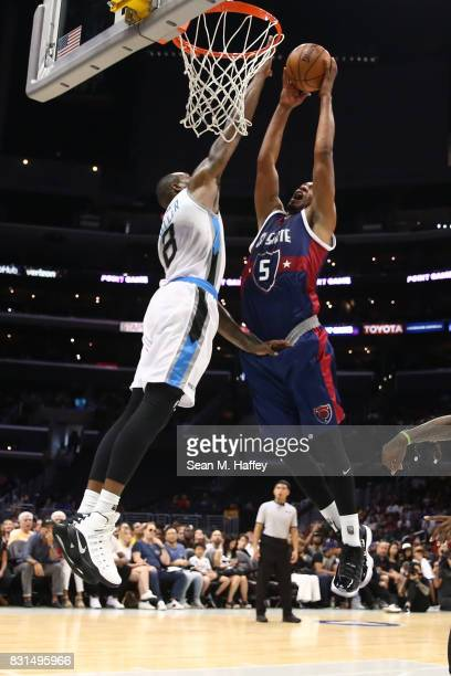 Dominic McGuire of the TriState goes up for a dunk against Rasual Butler of the Power during week eight of the BIG3 three on three basketball league...