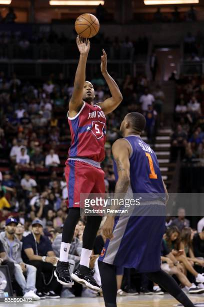 Dominic McGuire of the TriState shoots the ball over DerMarr Johnson of the 3's Company in week nine of the BIG3 threeonthree basketball league at...