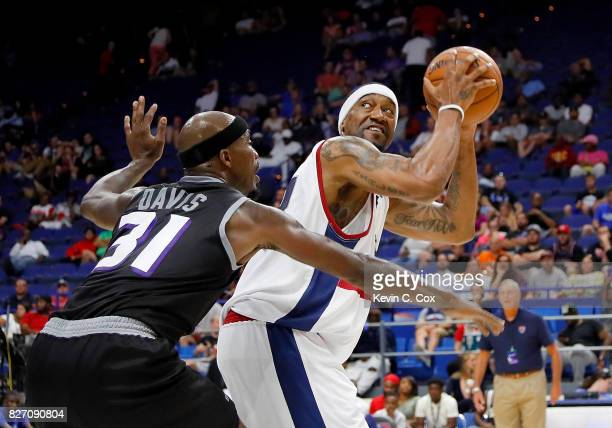 Dominic McGuire of TriState is guarded by Ricky Davis of Ghost Ballers during week seven of the BIG3 three on three basketball leagueat Rupp Arena on...