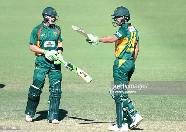 Dominic Michael of Tasmania celebrates after scoring a half century during the Matador BBQs One Day Cup match between Tasmania and the Cricket...