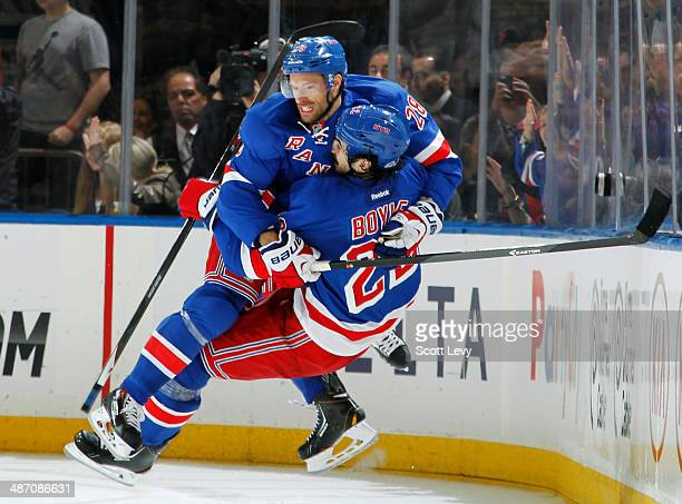 Dominic Moore and Brian Boyle of the New York Rangers celebrate after a second period goal against the Philadelphia Flyers in Game Five of the First...