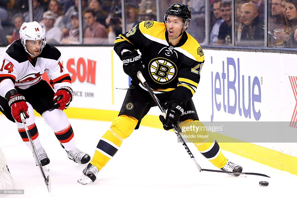 Dominic Moore #28 of the Boston Bruins breaks his stick looking to pass during the first period against New Jersey Devils at TD Garden on October 20, 2016 in Boston, Massachusetts.