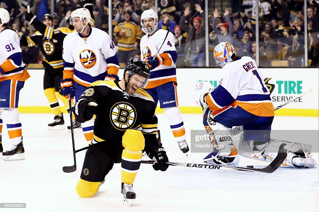 Dominic Moore #28 of the Boston Bruins celebrates after scoring against the New York Islanders during the third period at TD Garden on December 20, 2016 in Boston, Massachusetts. The Islanders defeat the Bruins 4-2.