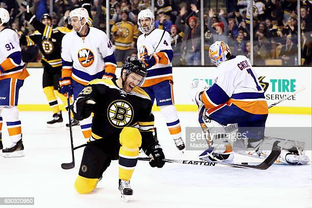 Dominic Moore of the Boston Bruins celebrates after scoring against the New York Islanders during the third period at TD Garden on December 20 2016...