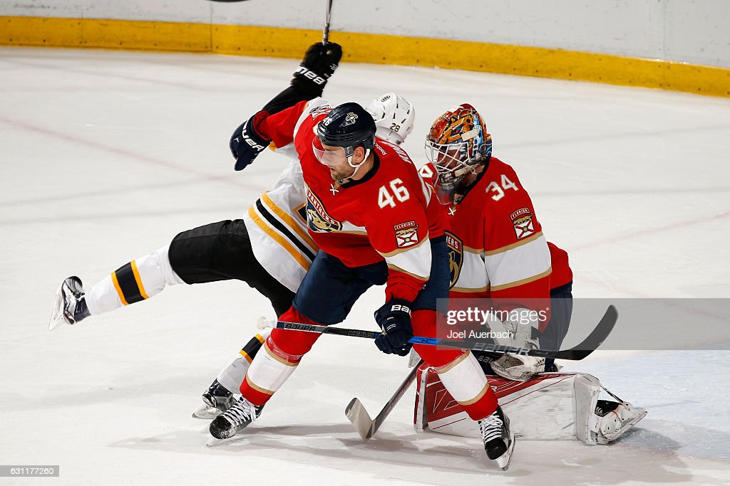 Dominic Moore #28 of the Boston Bruins collides with Jakub Kindl #46 as they run into Goaltender James Reimer #34 of the Florida Panthers during third period action at the BB&T Center on January 7, 2017 in Sunrise, Florida. The Bruins defeated the Panthers 4-0.